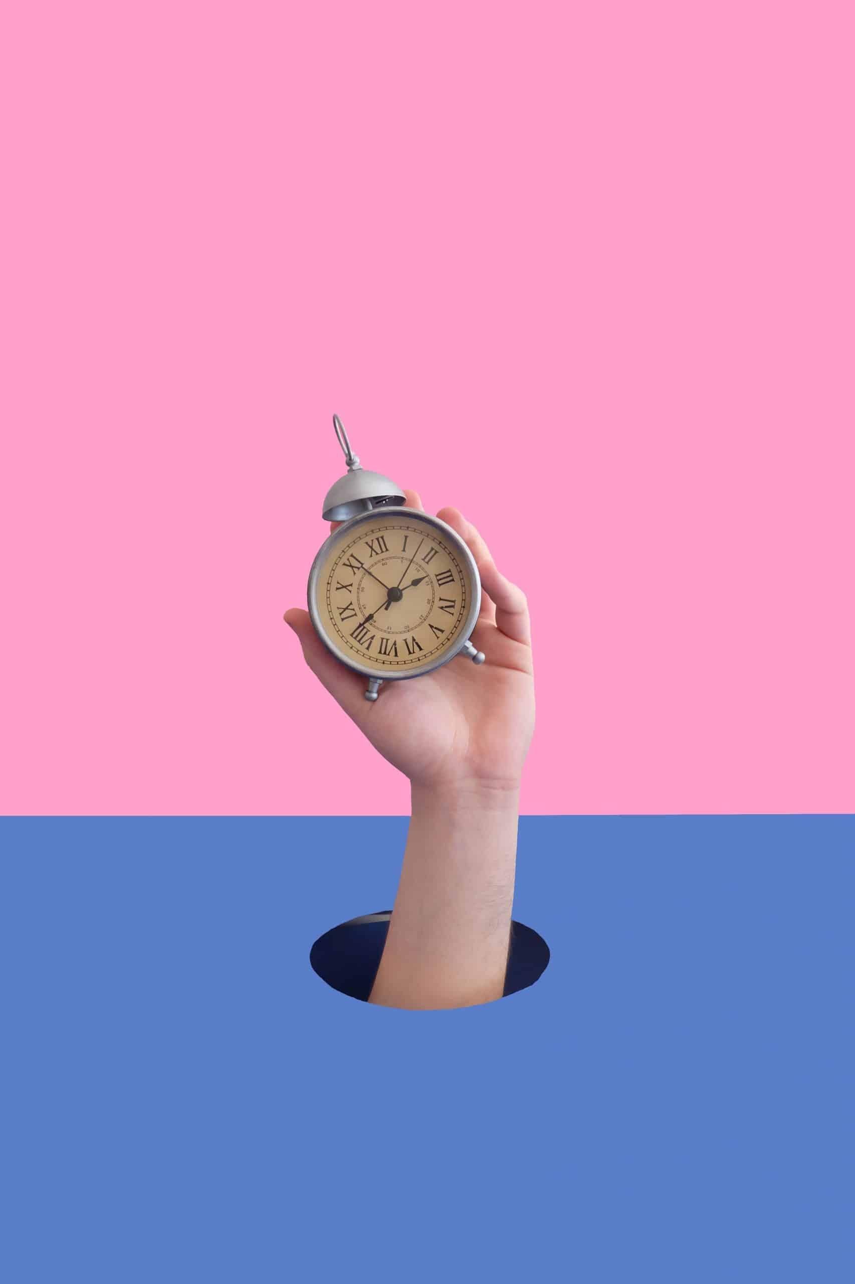 Hand Holding Clock